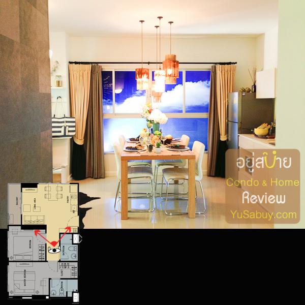 มุมมองจากทางเดินระหว่างห้องน้ำกับห้องนอน มองออกไปยังพื้นที่ส่วนรับประทานอาหารและเคาท์เตอร์ครัว